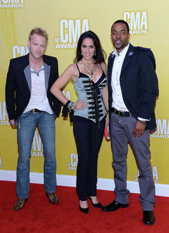 (L-R) Nick Hoffman, Krista Marie, and Damien Horne of The Farm attend the 46th annual CMA Awards at the Bridgestone Arena on November 1, 2012 in Nashville, Tennessee. Photo: Jason Kempin, Getty Images / 2012 Getty Images