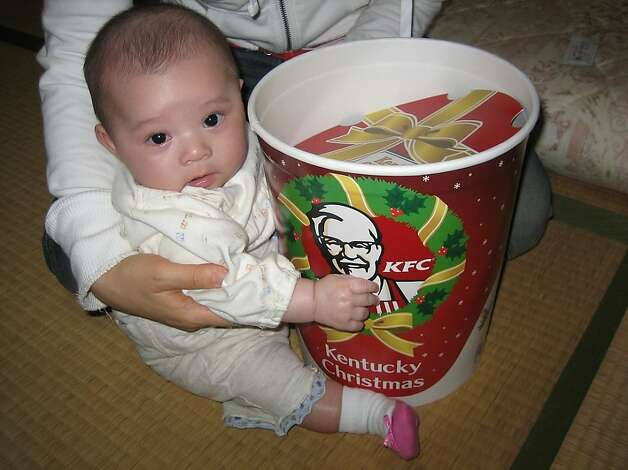 Japan - KFC for Christmas dinner   In many Japanese homes a KFC bucket with fried chicken is the main dish at Christmas. Thanks to a lack of turkeys and smart marketing by KFC the fried chicken  is so popular you have to order weeks in advance for the holidays. Ozchin/Flickr Photo: Ozchin (flickr) / SF