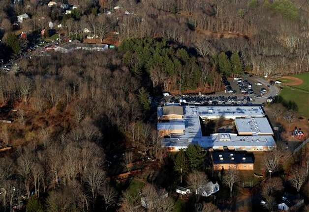 This aerial photo shows Sandy Hook Elementary School in Newtown, Conn., right, where authorities say a gunman opened fire inside the school in a shooting that left 27 people dead, including 18 children, Friday, Dec. 14, 2012. (AP Photo/Julio Cortez) Photo: Julio Cortez, ASSOCIATED PRESS / AP2012
