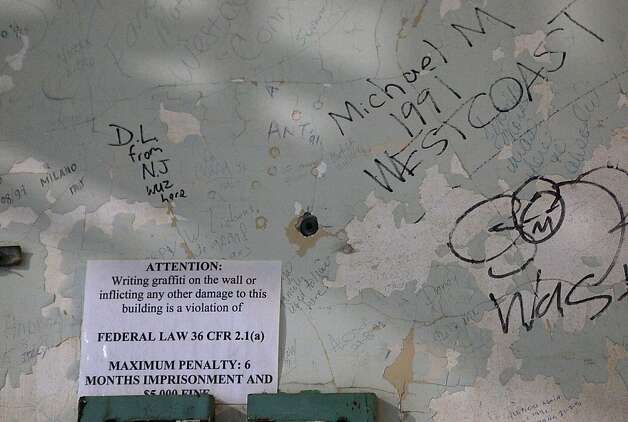A sign in the jail on Alcatraz in San Francisco, California, fining those seen making graffiti on the property.   The National Park service has recently restored the grafitti the American Indians had placed on the landmark water tank on Alcatraz during their 60's occupation. Photo: Liz Hafalia, The Chronicle