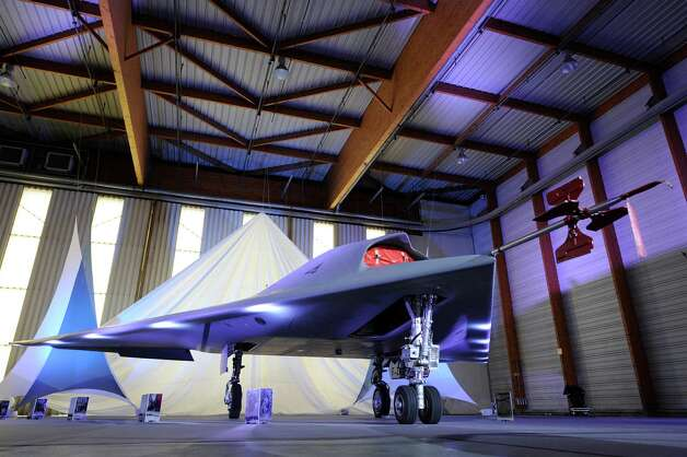 The nEUROn, an experimental Unmanned Combat Air Vehicle developed under a European consortium led by French defence group Dassault is put on show at the Dassault factory in Istres on December 19, 2012. The drone is expected to remain in testing for several years before a combat version is released sometime in 2015. Photo: BORIS HORVAT, AFP/Getty Images / 2013 AFP
