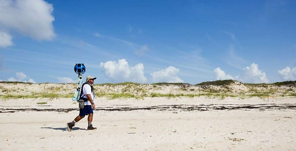 Google street view cameras are commonly seen on the roofs of cars. But in more remote locations, they have to be carried with a backpack. Photo: Colin Hackley, Associated Press