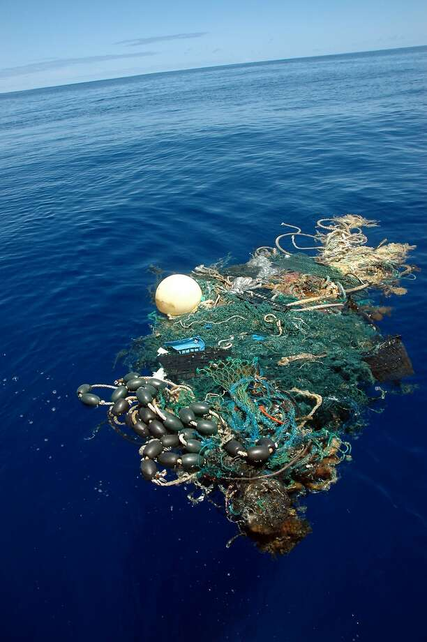FILE- This Aug. 11, 2009 file image provided by the Scripps Institution of Oceanography shows a patch of sea garbage at sea in the Pacific Ocean. A study released by the Proceedings of the National Academy of Sciences on Monday, June 30, 2014, estimated the total amount of floating plastic debris in open ocean at 7,000 to 35,000 tons. The results of the study showed fewer very small pieces than expected. (AP Photo/ Scripps Institution of Oceanography, Mario Aguilera, File) NO SALES Photo: Mario Aguilera, Associated Press