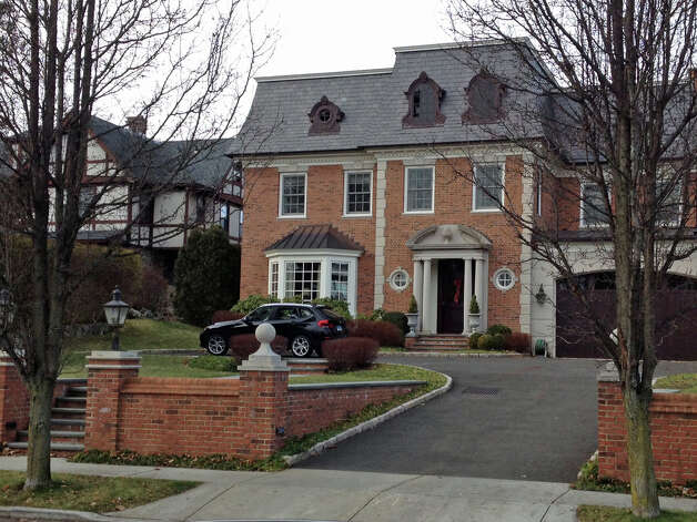 This central Greenwich home was the scene of an invasion/robbery Monday night. Photo: Robert Marchant, Anne W. Semmes / Greenwich Time