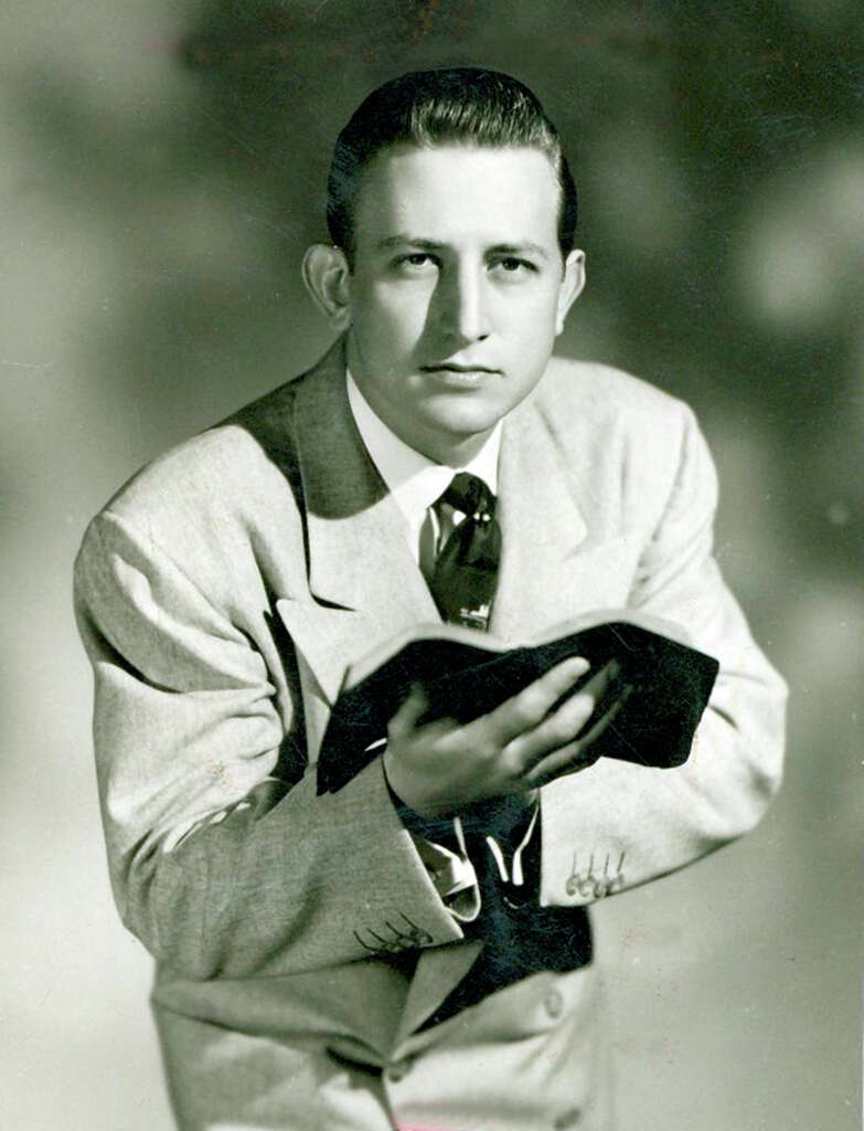 A youthful Howard E. Butt Jr. with a Bible. Photo: San Antonio Express-News / File Photo