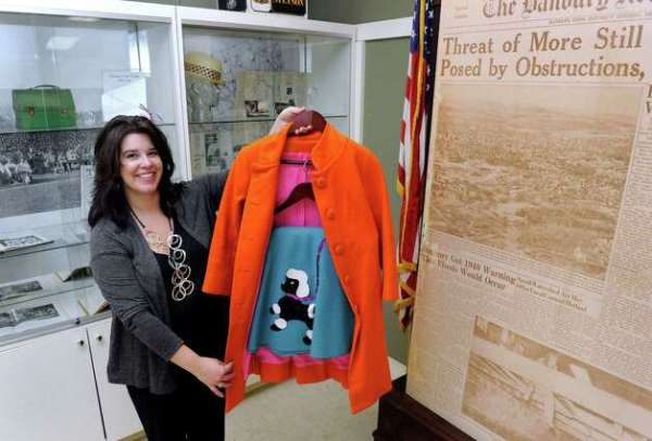 Brigid Guertin, executive director of the Danbury Museum and Historical Society, holds a poodle skirt and coat made in the 1950s. The clothing is part of a new exhibit at the museum called,
