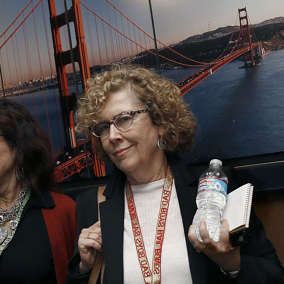Debra J. Saunders, leaving San Francisco. Interesting lanyard. Maybe she has a sense of humor, too. (San Francisco Chronicle photo)