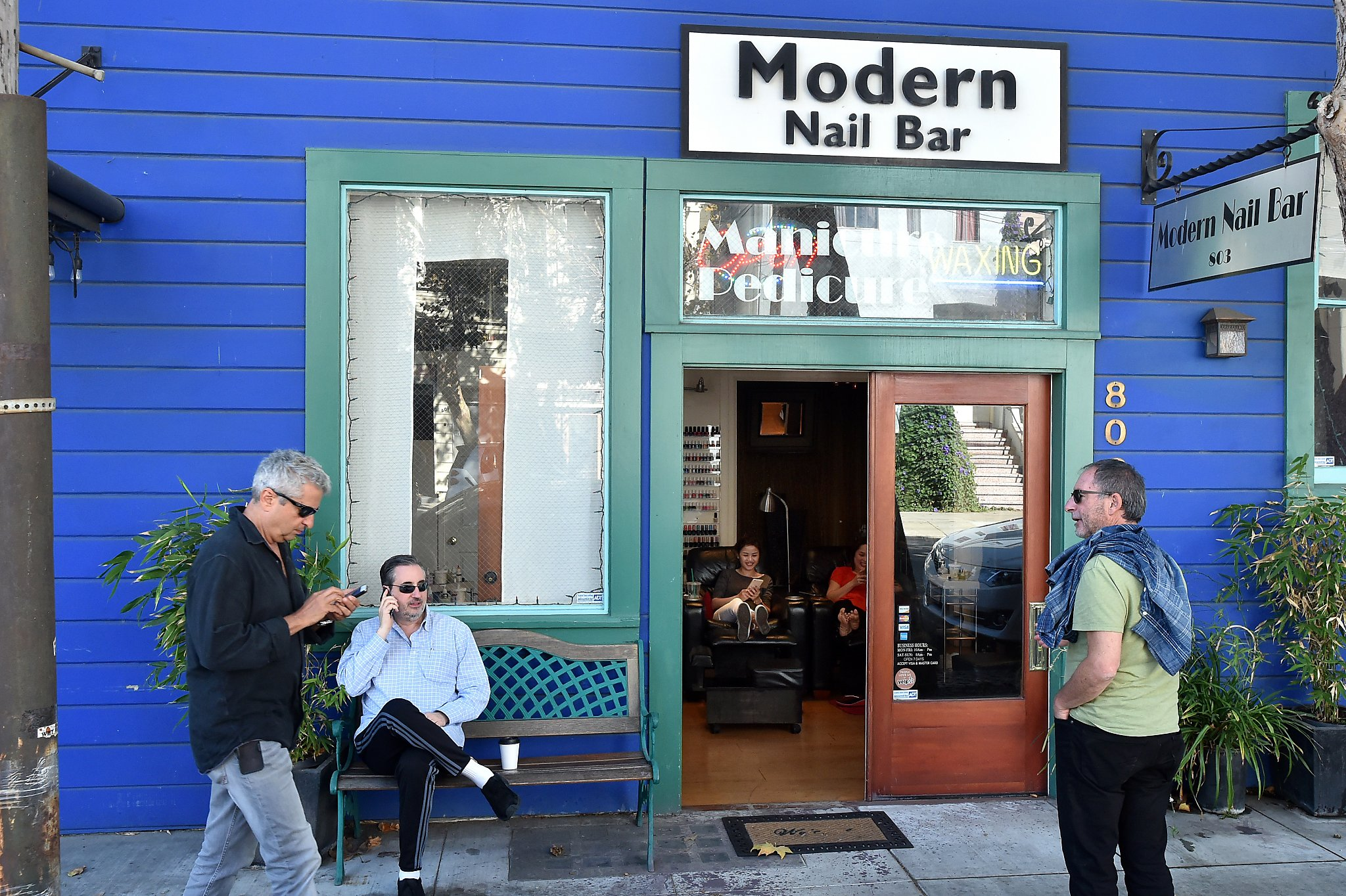 Men Congregate Near A Nail Salon In The Dogpatch Neighborhood Of San Francisco On October 16