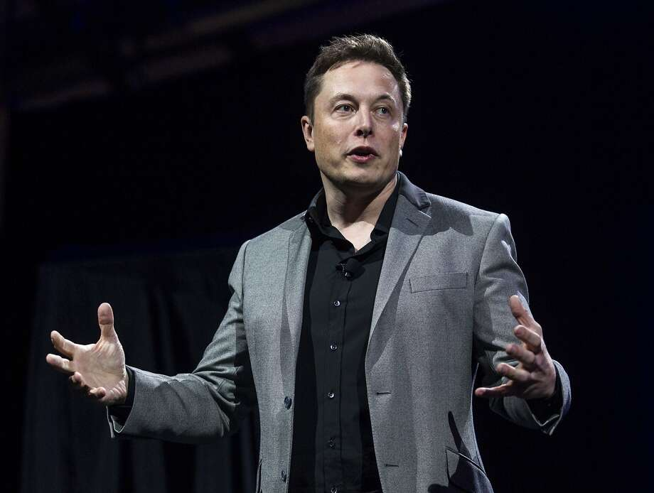 Elon Musk chairs the boards of Tesla Motors and SolarCity, and is the largest shareholder in each company. Photo: Ringo H.W. Chiu, Associated Press