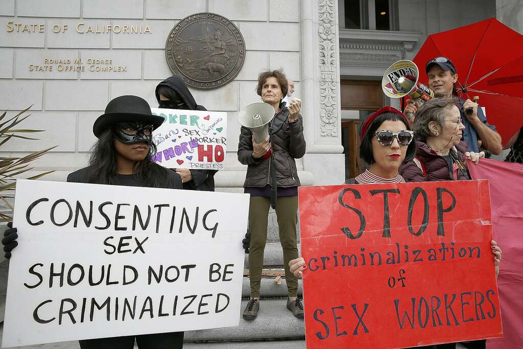 Taylor (left), US Pros and US Prostitutes Collective organizer Rachel West (back, middle) and Skyla Sensi (right) protest the raid on Backpage outside of the California Supreme Court on Tuesday, October 26, 2016, in San Francisco, Calif. Photo: Liz Hafalia, The Chronicle