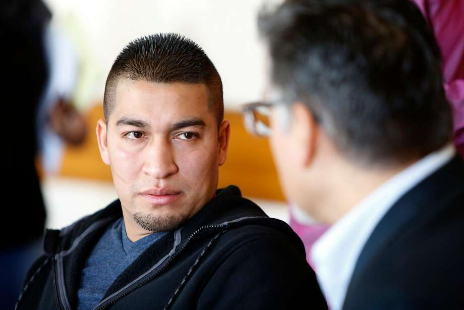 Mission district resident Pedro Figueroa-Zarceno talks about his two month  immigration detention after reporting his car being stolen to police as he talks to supervisor John Avalos during a press conference in city hall in San Francisco, California, on Friday,  February 5, 2016. Photo: Liz Hafalia, The Chronicle