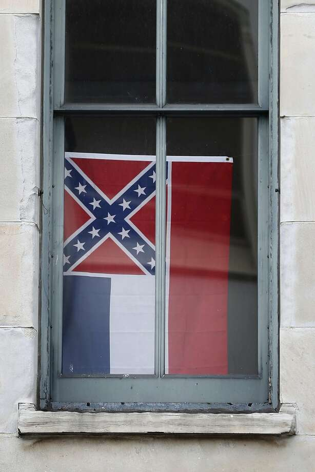 The state flag of Mississippi is displayed in a window at the San Francisco Mint on Monday, May 16, 2017 in San Francisco, Calif. Photo: Lea Suzuki, The Chronicle