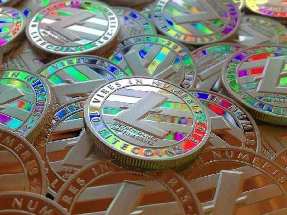 The fifth largest cryptocurrency on the market surpassed $80 per coin Friday afternoon, as more well-known digital currencies such as bitcoin and ethereum continue to reach new heights. Photo: Noah Luis