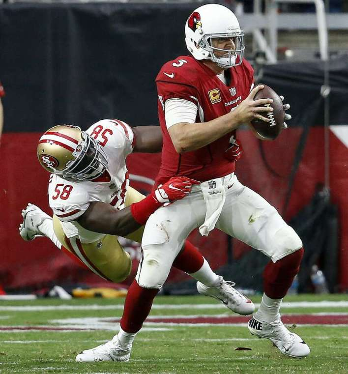 The 49ers had their hands on Carson Palmer all day long. Photo: Ross D. Franklin, Associated Press