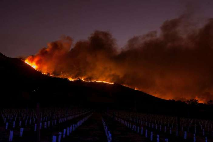 Flames moved through the hills above the Silverado Trail as a fast moving wind whipped wild fire raged though the Napa County on Monday, October 9, 2017. Photo: Peter DaSilva, Special To The Chronicle