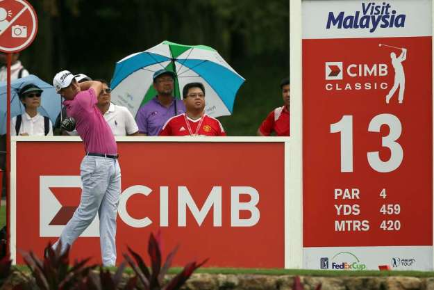 Justin Thomas swings away during round one of the CIMB Classic in Kuala Lumpur, Malaysia, where he is the defending champion. Photo: Stanley Chou, Getty Images