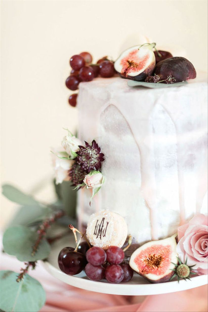 modern fall wedding cake with drip icing and figs