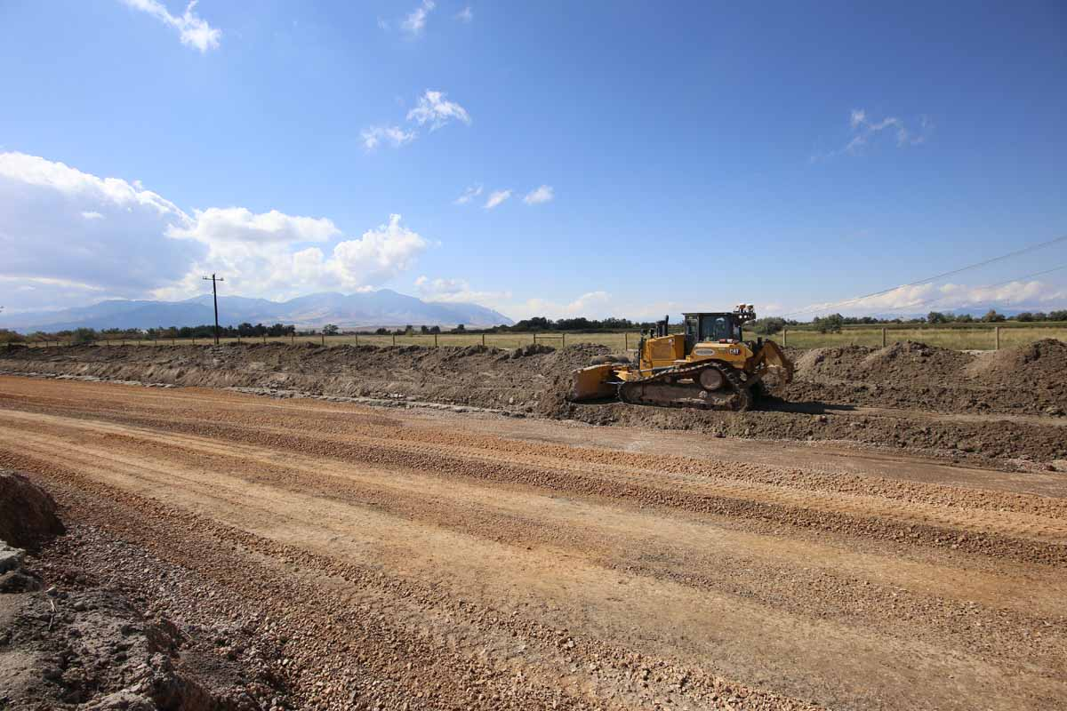 Utah Prison Offsite Utility Construction dozer clearing excess earth for new road