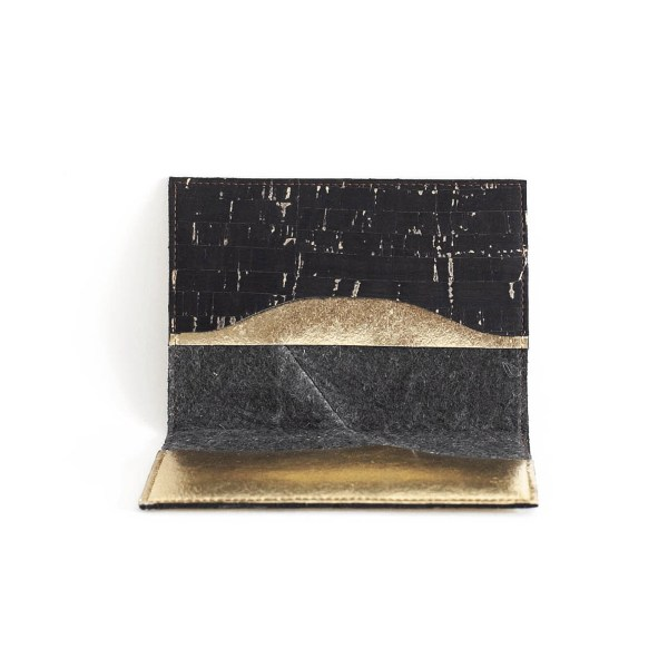 Interior view of the Delia Passport cover in Piñatex Cork Black and Gold