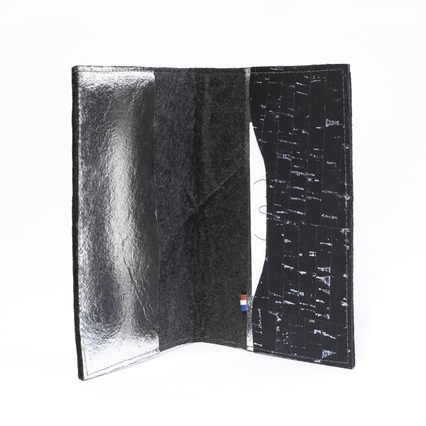 Interior compartment view of the Delia Passport cover in Black & Silver Piñatex & Cork