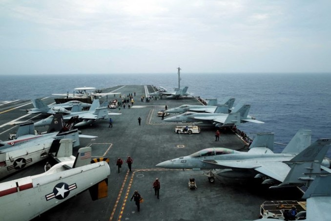 Exercise Malabar off the coast of Okinawa, Japan, with planes seen on an US aircraft carrier.