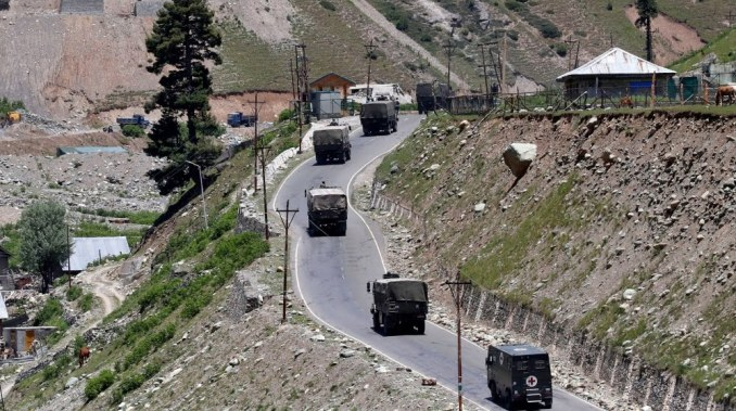 An Indian army convoy moves along Srinagar-Leh national highway, at Gagangeer, in east Kashmir's Ganderbal district, June 15, 2020. REUTERS/Danish Ismail