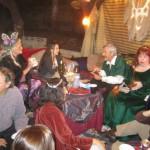 Partygoers at the Flaming Mumak Tavern