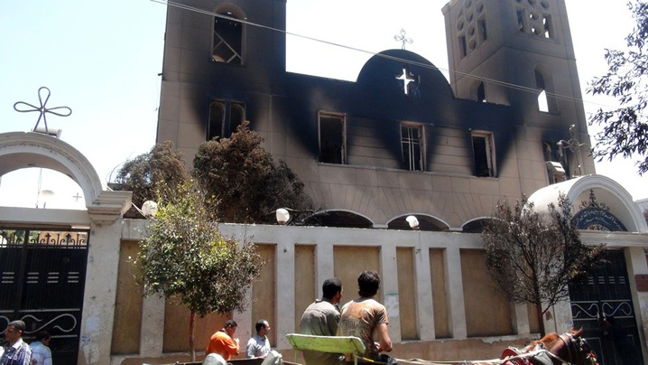 A picture taken on Aug. 14 shows the facade of the Prince Tadros Coptic church after being torched by unknown assailants in the central Egyptian city of Minya. (c) Stringer, AFP, Getty Images, 14th August 2013; PBS Newshour, 19th August 2013