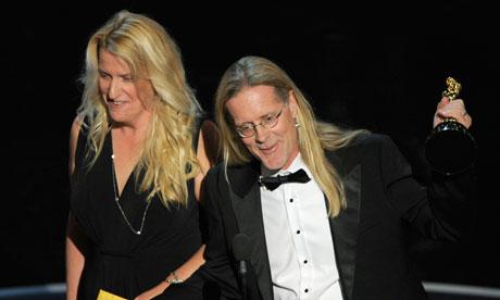 Karen Baker Landers and Per Hallberg accept the award for best sound editing for Skyfall. Baker Landers just edges Hallberg in the styling stakes