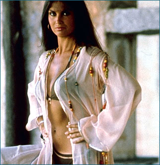 Naomi (played by the sexy British actress Caroline Munro),