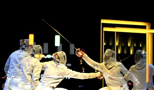 Multiple exposure photos of West Java Idon Jaya Wiguna (r) competes against South Sumatra Ricky Dhisulimah during The National Games Men Sable Fencing finals in Harris Hotel, Bandung, West Java, Friday, September 23, 2016. Idon snatch gold after win 15-13. JP/Seto Wardhana.