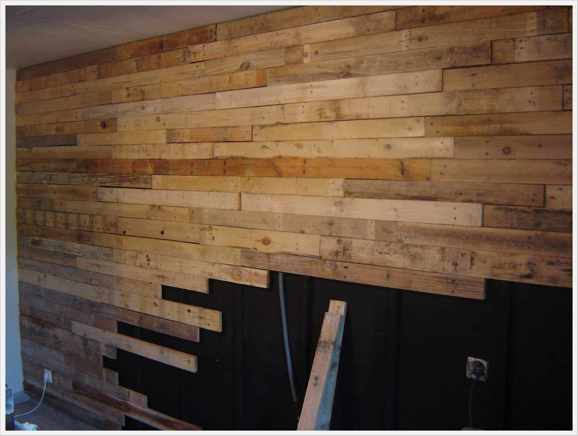 wall made out of 120 reclaimed pallets