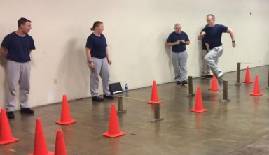 Potential officers performing a training course with cones.