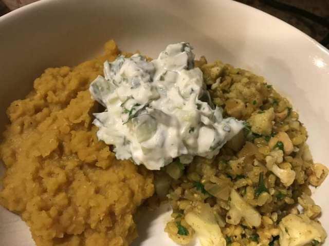 Cauliflower pilaf, dhal, and scallion cucumber raita