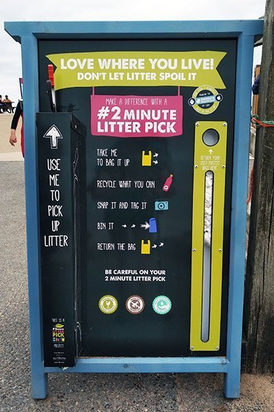 Do a 2 minute litter pick: everything you need is attached to the board including bags and a litter picker. This board is near the beach in Bude, Cornwall.