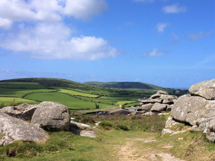 Granite tors on top of Trencrom Hill, St Michael's Way hike Cornwall, UK.