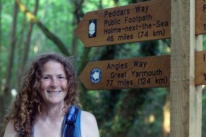 Working through my bucket list: Stephanie Boon standing beside the Peddars Way National Trail sign