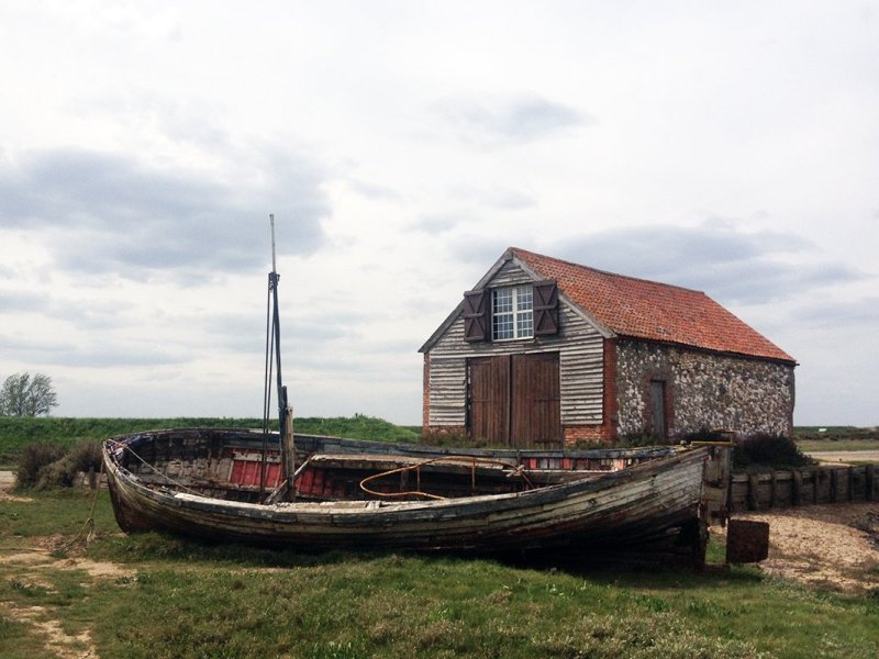 Boat House and rotting wooden boat. Norfolk Coast Path and Peddars Way National Trail. Copyright Stephanie Boon 2018. All Rights Reserved.
