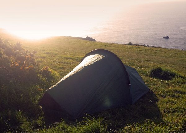 Tent on the cliff tops in bright sunlight on The South West Coast Path 2019. South Devon UK