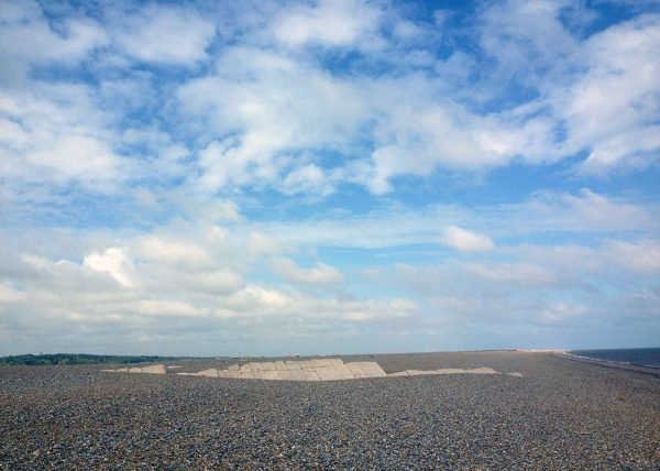 Blue skies with fluffy white cumulus clouds over a wider expanse of shingle beach. Peddars Way and Norfolk Coast Path National Trail, 2018