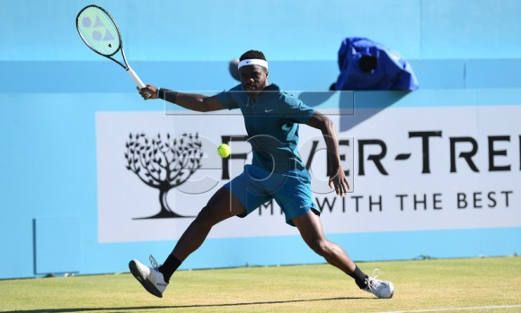 Frances Tiafoe of the US in action against Jeremy Chardy of France during their quarter-final tennis match at the Fever Tree Championship at Queen's Club in London, Britain, 22 June 2018. EPA-EFE/NEIL HALL