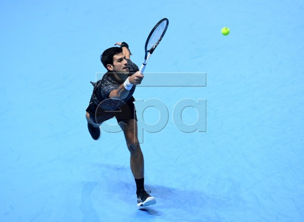 Serbia's Novak Djokovic returns against US player John Isner during their men's singles round-robin match on day two of the ATP World Tour Finals tennis tournament at the O2 Arena in London, Britain, 12  November 2018.  EPA-EFE/FACUNDO ARRIZABALAGA