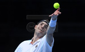 US player John Isner returns against Serbia's Novak Djokovic during their men's singles round-robin match on day two of the ATP World Tour Finals tennis tournament at the O2 Arena in London, Britain, 12  November 2018.  EPA-EFE/FACUNDO ARRIZABALAGA