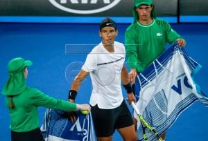 Rafael Nadal of Spain receives a towel form a ballgirl during his Men's Singles semi-final match against Grigor Dimitrov of Bulgaria at the Australian Open Grand Slam tennis tournament in Melbourne, Victoria, Australia, 27 January 2017.  EPA/LYNN BO BO