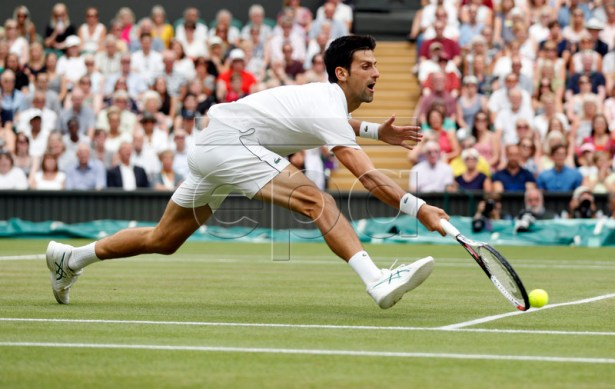 Novak Djokovic of Serbia returns to Rafael Nadal of Spain in their semi final match during the Wimbledon Championships at the All England Lawn Tennis Club, in London, Britain, 14 July 2018. EPA-EFE/NIC BOTHMA / POOL EDITORIAL USE ONLY/NO COMMERCIAL SALES
