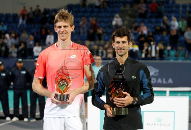 Winner Novak Djokovic of Serbia (R) and second placed Kevin Anderson(L) of South Africa pose after the final match at the Mubadala World Tennis Championship 2018 in Abu Dhabi, United Arab Emirates, 29 December 2018.  EPA-EFE/ALI HAIDER