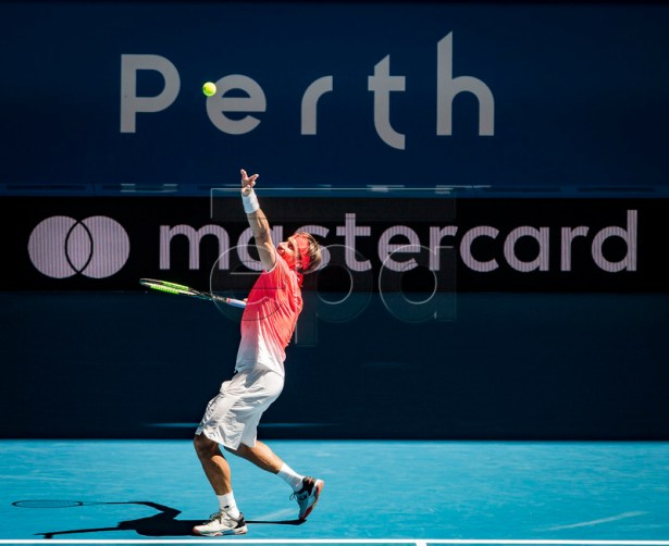 David Ferrer of Spain in action during the men's singles match between Germany and Spain on day 2 of the Hopman Cup tennis tournament at RAC Arena in Perth, Western Australia, Australia, 30 December 2018.  EPA-EFE/TONY MCDONOUGH AUSTRALIA AND NEW ZEALAND OUT  EDITORIAL USE ONLY