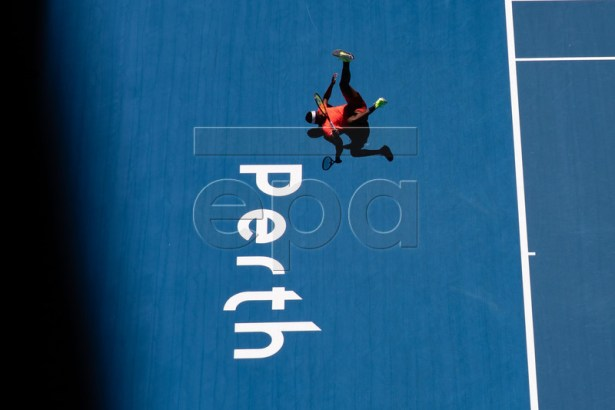 Frances Tiafoe of the USA falls over during the men's singles match between Frances Tiafoe of USA and Stefanos Tsitsipas of Greece on day three of the Hopman Cup tennis tournament at Perth Arena in Perth, Australia, 31 December 2018.  EPA-EFE/RICHARD WAINWRIGHT EDITORIAL USE ONLY AUSTRALIA AND NEW ZEALAND OUT