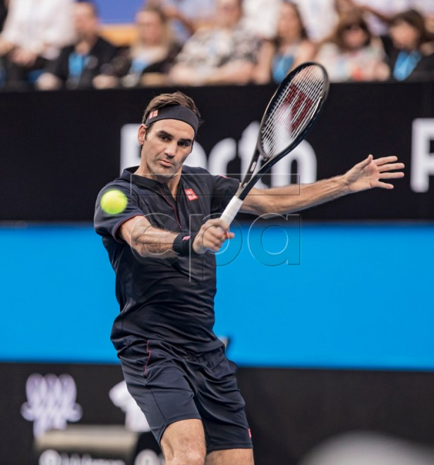 Roger Federer of Switzerland in action during the men's singles match between Roger Federer of Switzerland and Frances Tiafoe of the USA on day 4 of the Hopman Cup tennis tournament at RAC Arena in Perth, Western Australia, Australia, 01 January 2019.  EPA-EFE/TONY MCDONOUGH AUSTRALIA AND NEW ZEALAND OUT  EDITORIAL USE ONLY