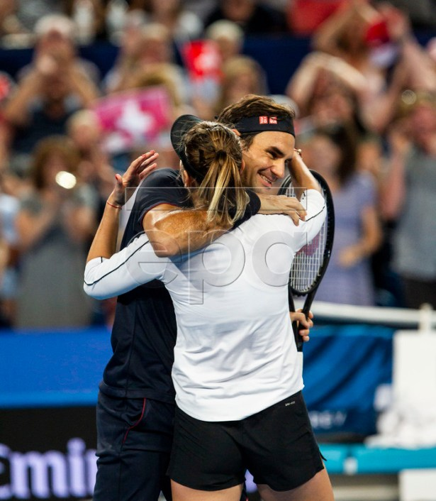 Belinda Bencic (front) and Roger Federer of Switzerland celebrate their win in the mixed doubles match between Switzerland and Germany on day 8 of the Hopman Cup tennis tournament at RAC Arena in Perth, Australia, 05 January 2019.  EPA-EFE/TONY MCDONOUGH AUSTRALIA AND NEW ZEALAND OUT  EDITORIAL USE ONLY